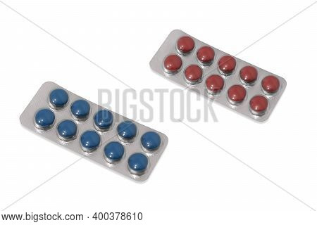 Two Packages With Round Blue And Red Pills, Tablets, Lozenges. Isolated On White.