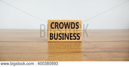 Crowds Business Symbol. Concept Words 'crowds Business' On Wooden Blocks On A Wooden Table. Beautifu