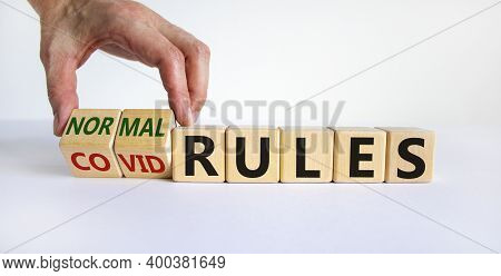 Covid Rules Symbol. Hand Turns Cubes And Changes Words 'covid Rules' To 'normal Rules'. Beautiful Wh