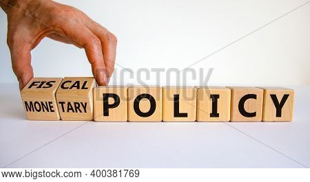 Fiscal Or Monetary Policy Symbol. Hand Turns Cubes And Changes Words 'fiscal Policy' To 'monetary Po