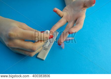 Coronavirus Covid-19 Quick Rapid Diagnostic Test, Nhs Medical Worker Collecting Patient Finger Prick