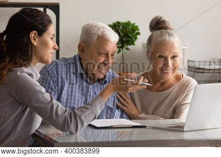 Female Consultant Have Meeting With Elderly Couple