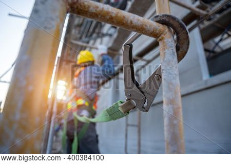 Construction Worker Wearing Safety Harness And Safety Line Working At High Place, Fall Arrestor Devi