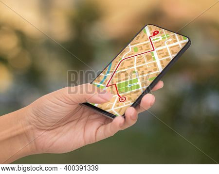 Unrecognizable Female Using Gps Map Navigation App On Smartphone While Walking Outdoors In City, Wom
