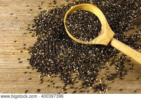 Chia Seeds Salvia Hispanica In Wooden Spoon On Old Natural Wooden Table Background. Healthy Food, Su