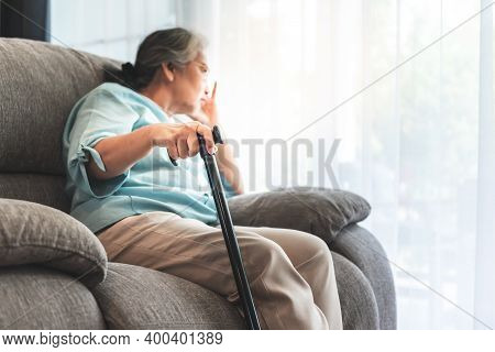 Close Up Images, Hand Of Asian Elderly Woman Which Holds The Cane To Support, Sitting Absent Lonely