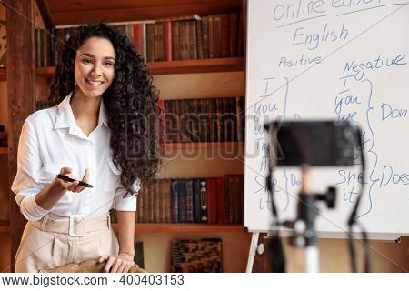 Online Tutoring. Portrait Of Cheerful Woman Professor Giving Virtual Class, Standing At Whiteboard,