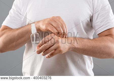 Dermatitis, Eczema, Allergy, Psoriasis Concept. Unrecognizable Man Scratching Itch On His Hand, Clos