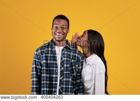 Big Secret, Sharing News. Mysterious Millennial African American Student Lady In Casual Whispers In