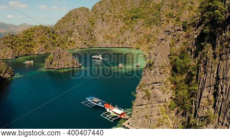 Aerial View Tourist Boats In Lagoon. Kayangan Lake. Lagoons, Mountains Covered With Forests.coves Wi