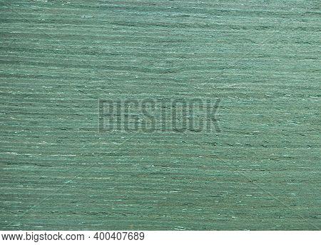 Natural Dyed Ash Green Ripple Wood Texture Background. Dyed Ash Green Ripple Veneer Surface For Inte