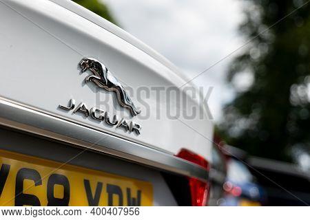 Scotland - August 12, 2019: Badge Of The Jaguar Automotive Company On A Rear Part Of White Jaguar Se