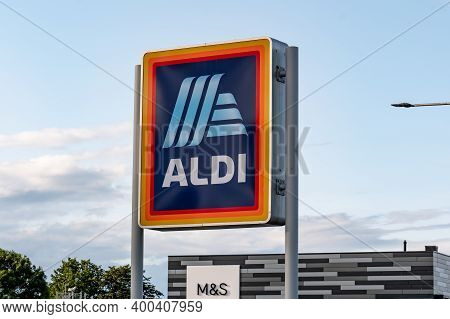 Saint Andrews, Scotland - August 12, 2019: The Banner With Logo Of Aldi Grocery Store At Shopping Ma