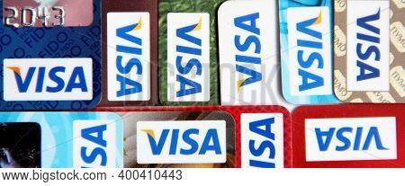 Different Credit Cards With Visa Brand Logo. Close Up Of Many Visa Credit Cards. Plastic Bank Cards