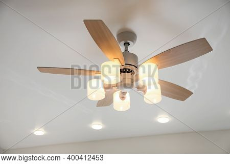 Modern Ceiling Fan With Lamps Indoors. Interior Element