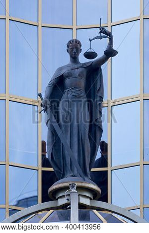 Irkutsk, Russia - July 25 2018: Bronze Statue Of Lady Justice Atop Of The Main Entrance Of The Arbit