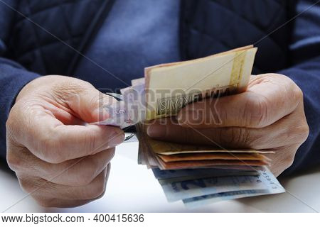 Approach To Hands Of A Woman Counting Brazilian Banknotes
