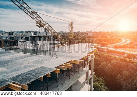 Construction Site Of New High Residential Building, Industrial Construction Crane And Other Industry