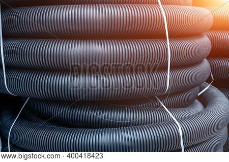 Many Rolled Colis Of New Black Corrugated Goffred Plastic Electric Plumbing Drainage Pipe Prepared F