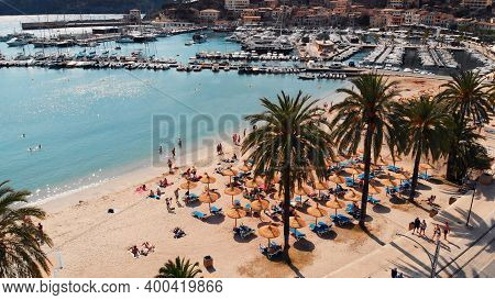 Bird View Of The Crowded Beach Of Tourists In Port Soller, Mallorca. High Quality Photo