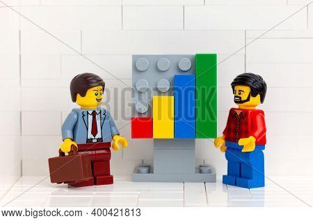 Tambov, Russian Federation - November 14, 2020 Two Lego Minifigure Entrepreneurs Having A Meeting In