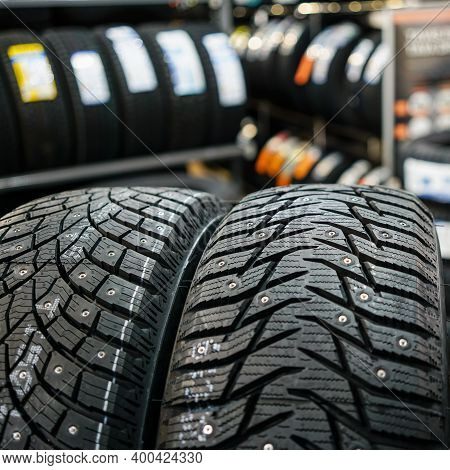 Closeup View Of Two Studded Winter Tires With Different Treads