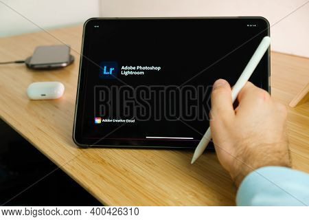 Adobe Photoshop Lightroom Is Used With Apple Pencil On Ipad Pro Tablet . Man Using Application On Th