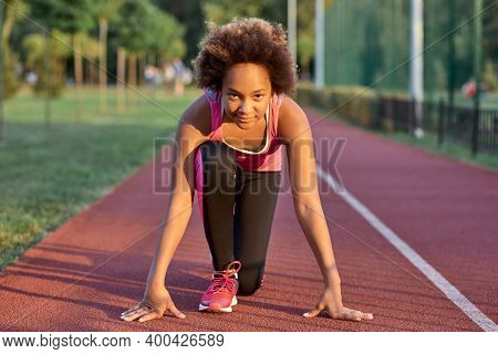 Adorable Little Girl Standing In Start Position Before The Sprint