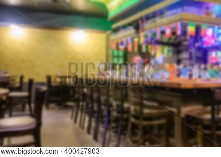 Blurred Interior Of An Empty Cafe. Various Drinks At The Bar In A Modern Pub. Presentation Mock-up.