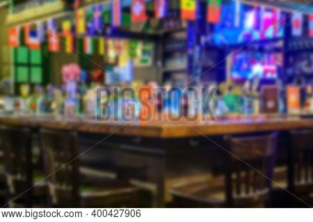 Bar Counter In A Modern Pub. Blurred Interior Of An Empty Cafe. Presentation Layout.