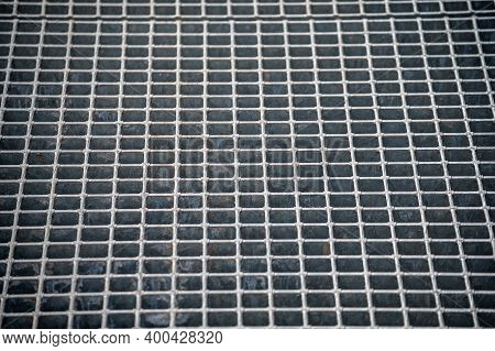 Metal Ventilation Grill Of The Subway. Industrial Texture Close Up. Metal Mesh Texture. Abstract Bac