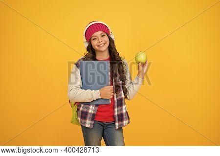 Give Me Break. Happy Child Hold Apple Yellow Background. Little Girl Enjoy School Break. Healthy Eat