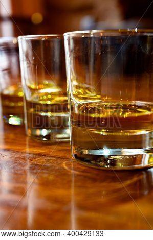 Flight Of Scottish Whisky, Tasting Glasses With Variety Of Single Malts Or Blended Whiskey Spirits O