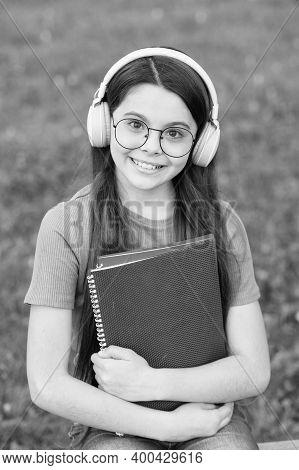 Audio Listening And Study. Happy Child Enjoy Listening To Music. Small Girl Practise Listening Skill
