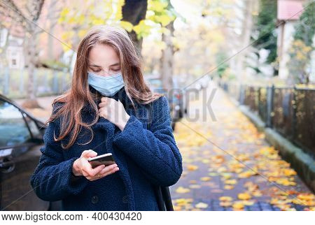 Portrait Of A Happy Woman Doing Her Shopping Using Her Cell Phone On The Street, Lifestyle Concepts.