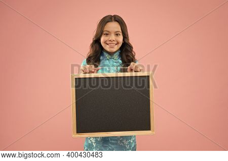 School Publicity. Happy Kid Hold Blackboard Pink Background. Little Child Smile With Tidy Publicity