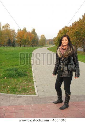 Girl Walkingto The Park