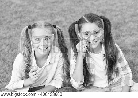 Summer Party. Happy Children Hold Prop Glasses. Party Photobooth. Party Girls Celebrate On Green Gra