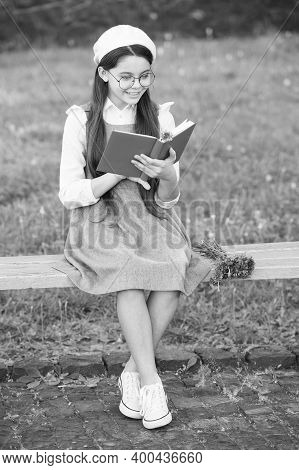 Practice Makes Perfect. Little Girl Read Book On Park Bench. Reading Homework. Homework Assignment.