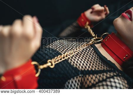 Sensual Female With Red Lips, Leather Bondage Collar Choker And Handcuff
