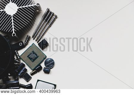 Computer And Laptop Hardware - Cpu, Fan Cooler, Battery, Capacitors, Radiator, Chip On The White Bac