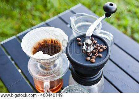 Drip Coffee Barista Pouring Water On Filtered Brewing, Make Cup Hand Drip Coffee In Glass Jar On Out