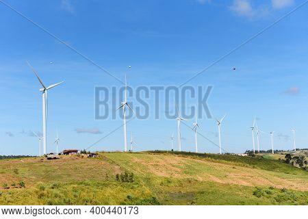 Wind Turbine Landscape Natural Energy Green Eco Power Concept At Wind Turbines Farm Blue Sky Backgro