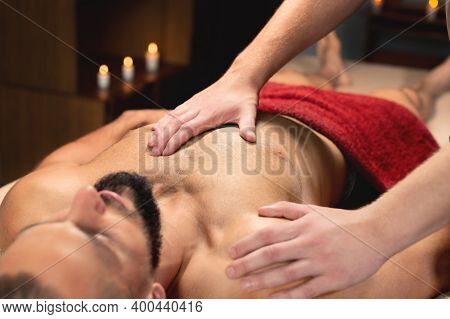Close-up Medical Sports Massage Of The Chest And Pectoral Muscles.