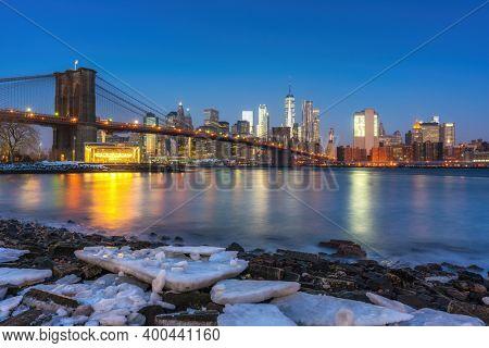 Brooklyn bridge East river and Manhattan at winter dawn, New York City