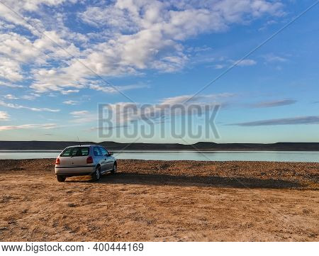 Rio Gallegos, Argentina- September 7, 2019: Beautiful Landscape And Car Without Markings Or Informat