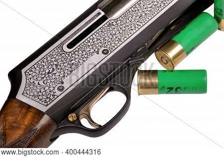 Shotgun Bullet And Trigger Mechanism Isolated On White Background, Hunting Shotgun Detail