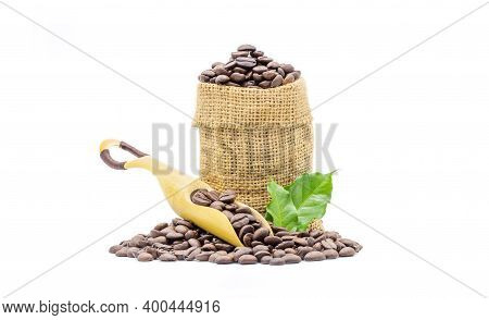 Coffee Beans Roasted In Scoop Beans And In Sack With Coffee Leaves Isolated On White Background.