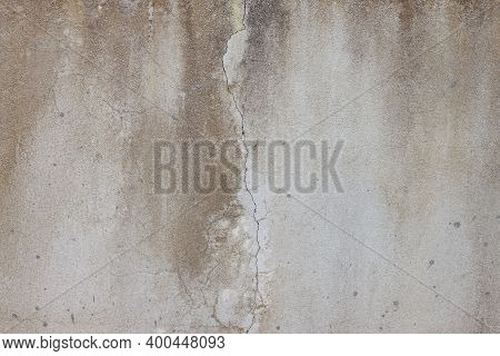 Textures Of Old Cement Wall Had Cracks And Stains For Background.