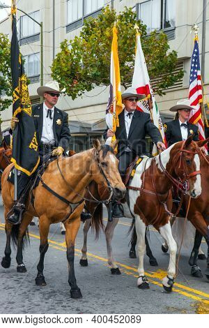 SAN FRANCISCO, USA - OCTOBER 11, 2009: Columbus Day celebration. Equestrian parade in honor of the national holiday. Dressy riders on beautiful well-groomed horses carry US flags